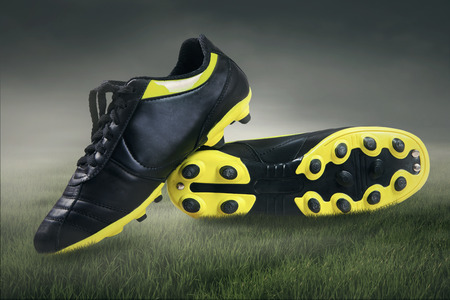 sport clothes: Footbal boots. Soccer boots. shoot at field Stock Photo