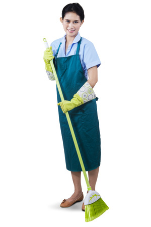 Cleaning lady using a broom to sweeping the floor photo