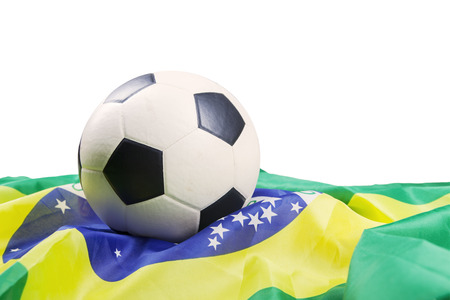 Soccer ball with brazilian flag isolated on white background photo
