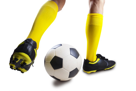 dribbling: Closeup of soccer player dribbling the ball isolated on white background Stock Photo
