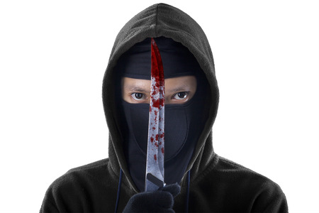 holding a knife: A frightening man holding bloody knife. isolated on white background Stock Photo