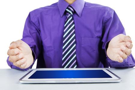 Portrait of businessman showing a digital tablet photo
