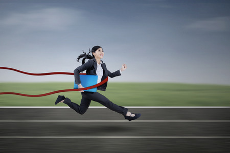 Asian businesswoman winning a business race outdoor photo