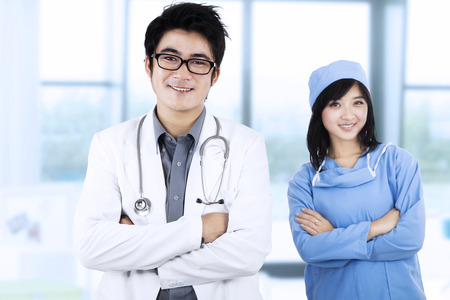 filipino adult: Portrait of confident young medical team at hospital