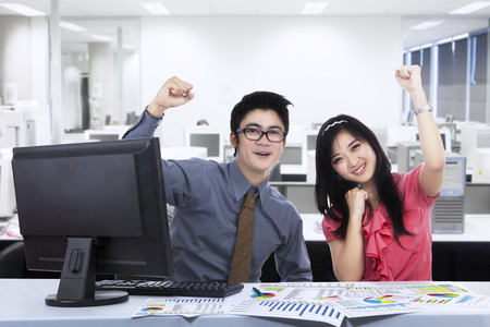 asian business team: Happy business team expressing success at office