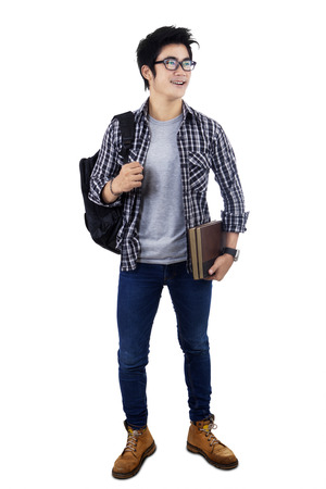 Male college student standing on white background photo