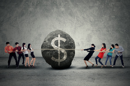 pulling money: Business people with obstacle