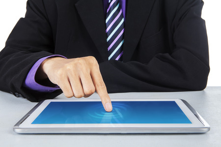 Businessman with finger touching screen of a digital tablet  photo