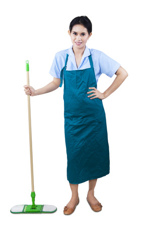 Cleaning lady holding mop standing on white background photo