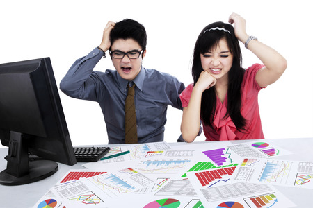 Stressed business team having problem while analyzing business chart Stock Photo
