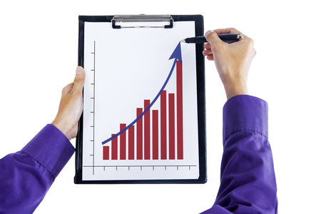 Hand drawing a graph on a clipboard, isolated on white background photo