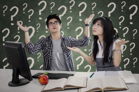 Confused students having many questions for solution photo