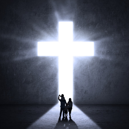 Christian family walking towards a Cross of Jesus Stok Fotoğraf