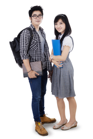 Couple students standing and smiling at camera.  photo