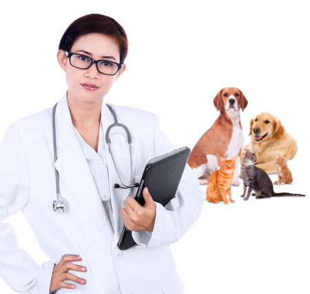 Female vet smiling with pet - isolated over a white background photo