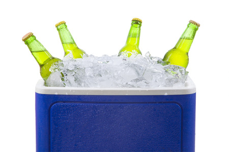 cooler: Closeup of an ice chest full of ice and assorted beer bottles. isolated on white