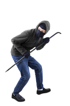 Burglar with a crowbar is slink on white background