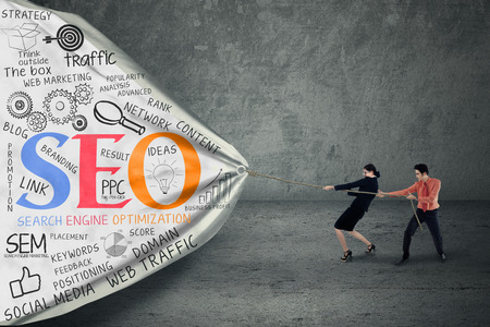 Portret van twee mensen uit het bedrijfsleven trekken SEO banner Stockfoto