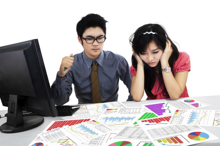 Stressed business team having problem while analyzing business chart photo