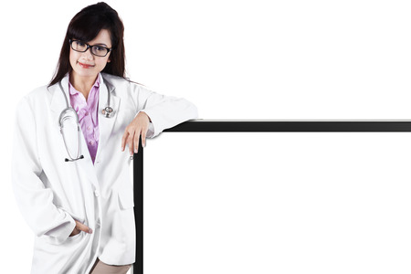 Doctor with empty board as a copy space for text or design photo