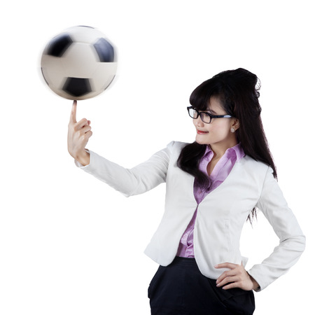 Female football manager playing a soccer ball on finger photo