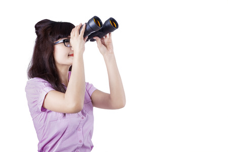 job searching: Portrait of a businesswoman searching for new job opportunities with binoculars.
