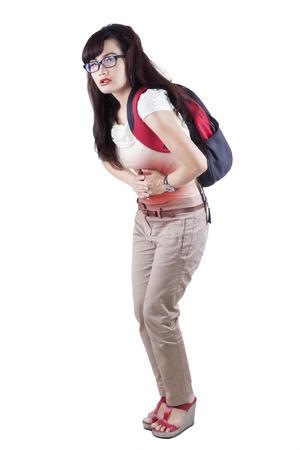 upset stomach: Woman having abdominal pain, upset stomach or menstrual cramps Stock Photo