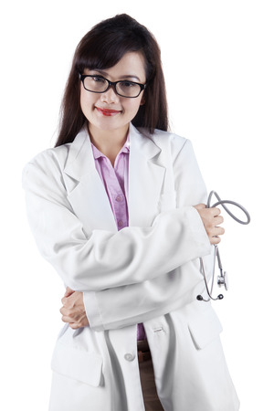 Close-up of a female doctor smiling isolated on white background photo