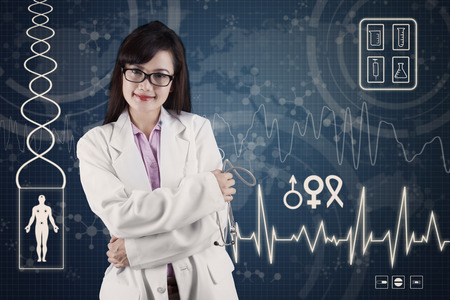 Female doctor standing in front of medical background  photo