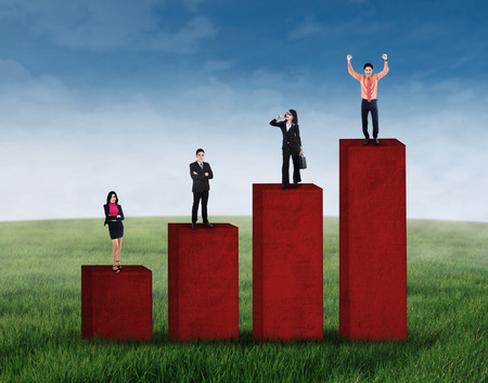 Business growth concept with business group standing on business chart Stock Photo - 28018251