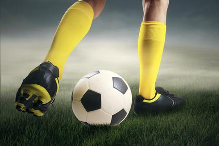dribbling: Closeup of soccer player dribbling the ball at field