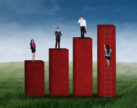 Business competition concept with business people standing on graph while the other try to climbing photo