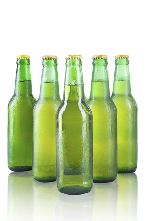 Bottles of beer with drops isolated on white  photo
