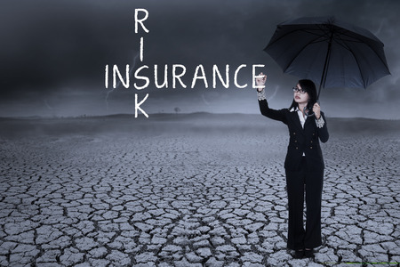 legal advice: Business woman writing insurance concept on the air. shot outdoors Stock Photo