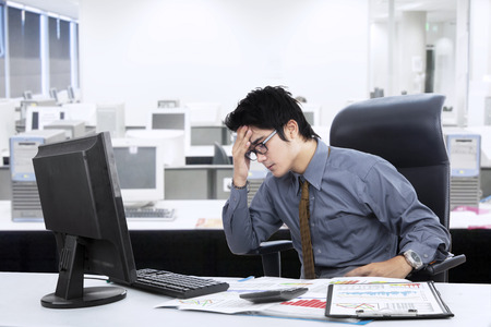 frustrated man: Young businessman stressful in the office