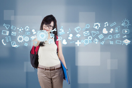 Female student using futuristic interface for accessing information photo