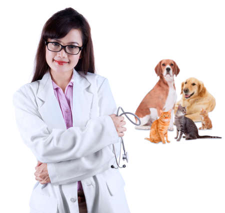 Female vet with pet - isolated over a white background photo
