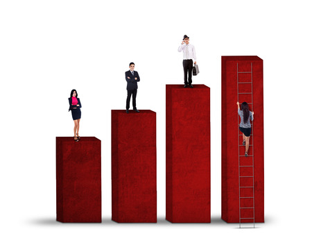 Business competition concept with business people standing on graph while the other try to climbing Stock Photo