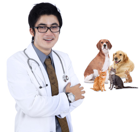 Vet smiling with pet - isolated over a white background photo