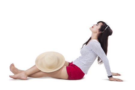 chinese hat: Beautiful woman wearing sun hat and sitting on white background