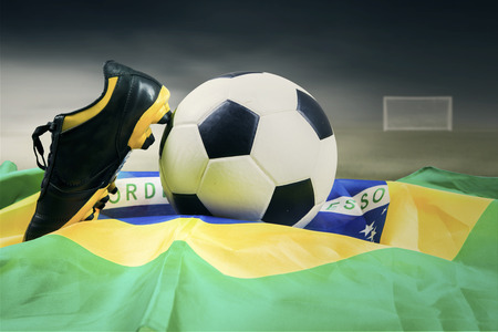 Soccer ball with brazilian flag on the field symbolizing soccer championship  photo