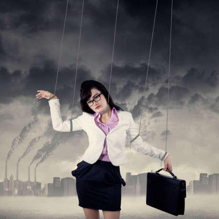 puppet woman:  Image of businesswoman hanging on strings like marionette