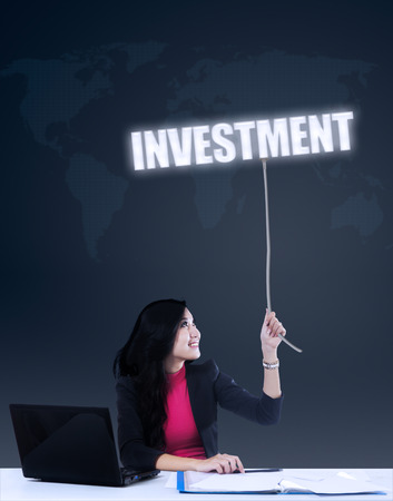Business concept - Businesswoman grabbing global investment  photo