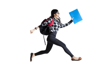 test deadline: Casual female student running. isolated on white background