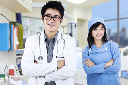 Portrait of confident young medical team at hospital photo