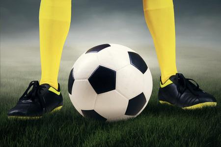 kickoff: Football or soccer ball at the kickoff of a game - outdoors Stock Photo