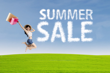 short sale: Happy young woman jumping near cloud of summer sale