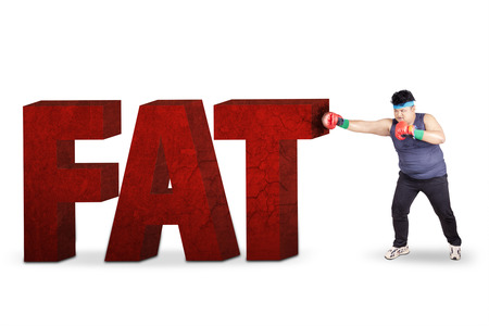 match box: Overweight man exercise to lose weight by boxing and punching a big obesity text
