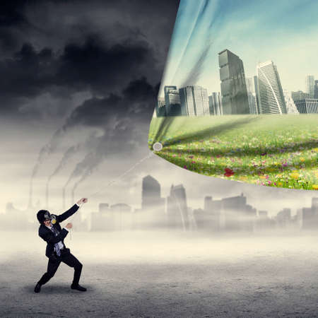 corporate waste: Businessman change the environment by pulling an air pollution banner to a banner of green city Stock Photo