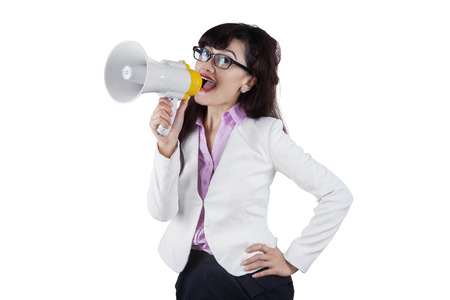 Business woman with megaphone yelling and screaming isolated on white background Stock Photo - 29230516